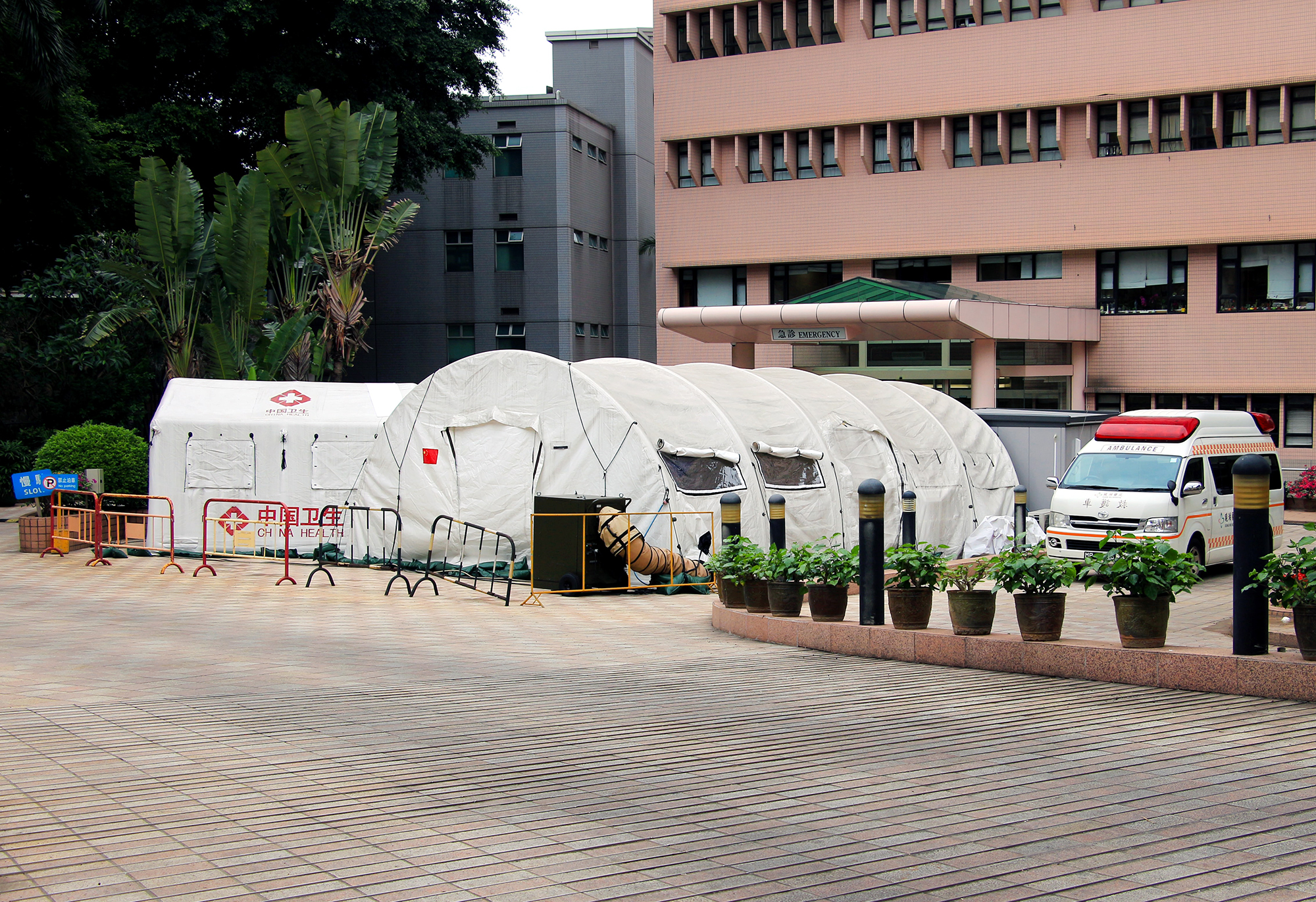 Medical tents set up at the emergency entrance of a hospital
